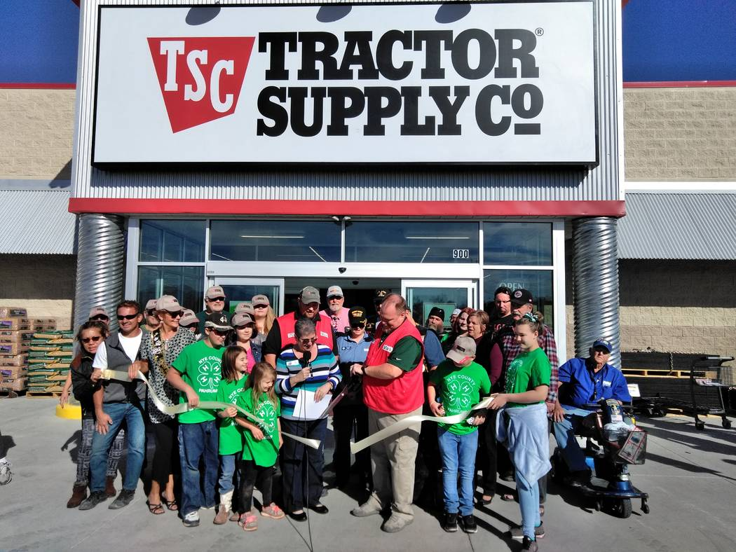 Selwyn Harris/Pahrump Valley Times Pahrump Tractor Supply Company Manager Mark Slingerland, with shears in hand, cuts the ribbon for the Saturday Nov. 11, grand opening. The new business is locat ...