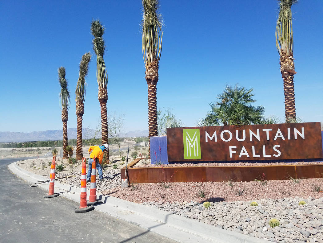 Horace Langford Jr./Pahrump Valley Times Crews work outside the Mountain Falls Development as shown in a photo taken this spring. Continued growth is occurring in that community.