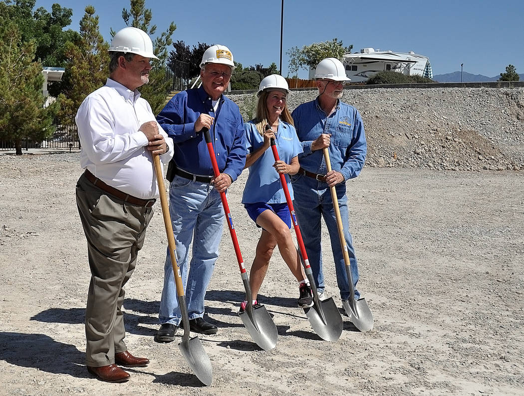 Horace Langford Jr./Pahrump Valley Times Nevada Assemblyman James Oscarson, R-Pahrump (left), Bill Loken, Gretchen Loken and Ken Murphy of Shadow Mountain Construction (right), turn dirt at the gr ...
