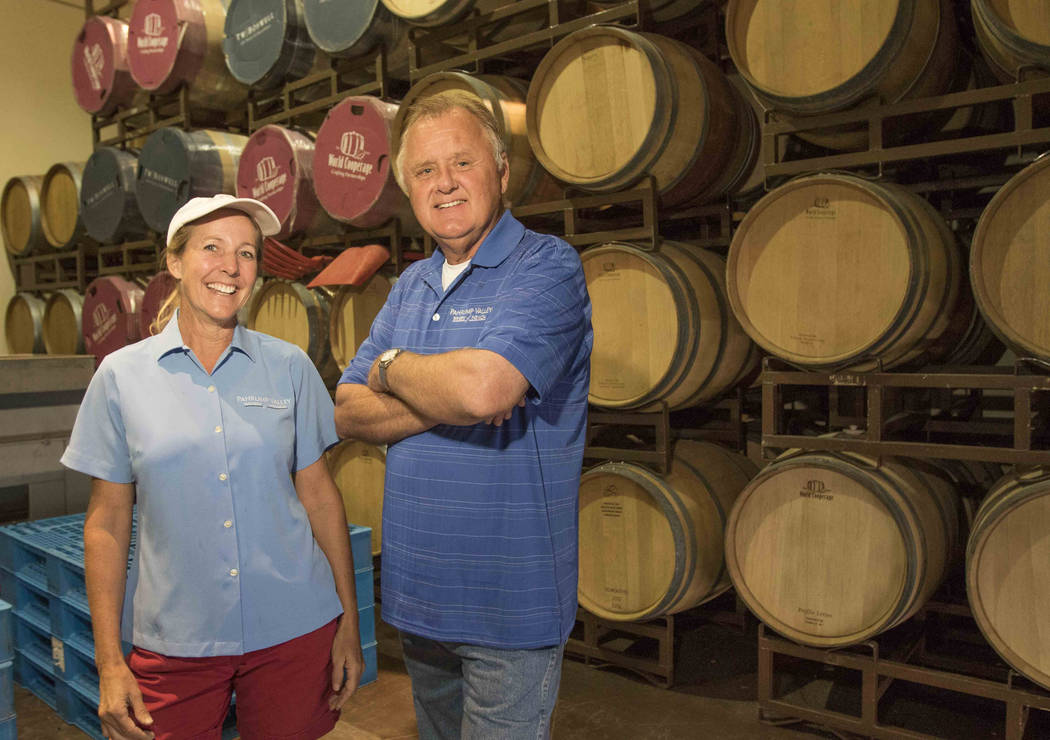 Winemakers Gretchen and Bill Loken pose in their wine making room during a grape harvest at the Pahrump Valley Winery in Pahrump, Nev., Thursday, Aug. 11, 2016. Richard Brian/Las Vegas Review-Jour ...