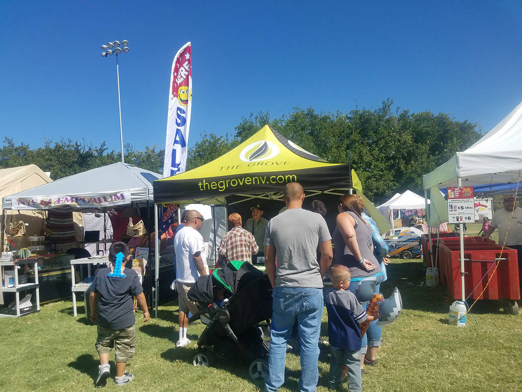 David Jacobs/Pahrump Valley Times A crowd gathers in front of a booth for The Grove marijuana dispensary at the Pahrump Fall Festival in September in Petrack Park. The Grove dispensary off Basin R ...