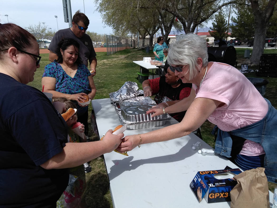 Selwyn Harris/Pahrump Valley Times More than 1,200 hamburgers were grilled up and served up, courtesy of volunteers from NyE Community Coalition's Holiday Task Force. Organizers thanked the numero ...