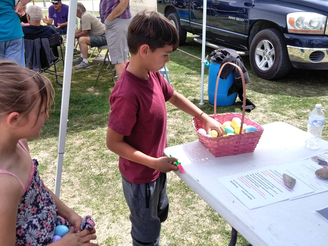 "Selwyn Harris/Pahrump Valley Times Abandoning the traditional Easter Egg Hunt, organizers opted for an ""Egg Scramble,"" where kids would visit the various booths in the park to collect their colorf ..."