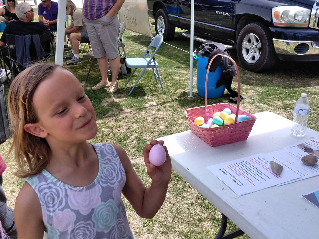 Selwyn Harris/Pahrump Valley Times A young Easter Egg seeker covets the prized object provided by more than 20 organizations during Saturday's Community Easter Picnic. The free event attracted hun ...