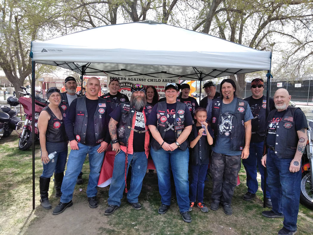 "Selwyn Harris/Pahrump Valley Times The booth consisting of members from Bikers Against Child Abuse, or ""BACA,"" was a very popular attraction at the Easter Day picnic.  ""Chrome,"" front and cent ..."