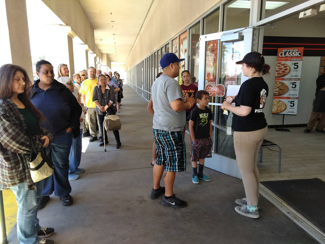 Selwyn Harris/Pahrump Valley Times Customers began lining up for free lunch courtesy of Pahrump's Little Caesars Pizza in the Albertsons Plaza. Beginning at 11:30 a.m., customers began received th ...