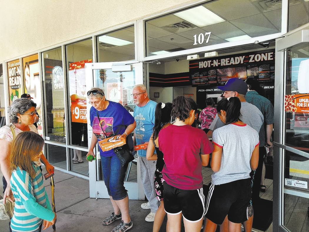 Selwyn Harris/Pahrump Valley Times Management and employees at Pahrump's Little Caesar's Pizza were fully prepared to handle the additional influx of customers seeking the company's offer of free  ...