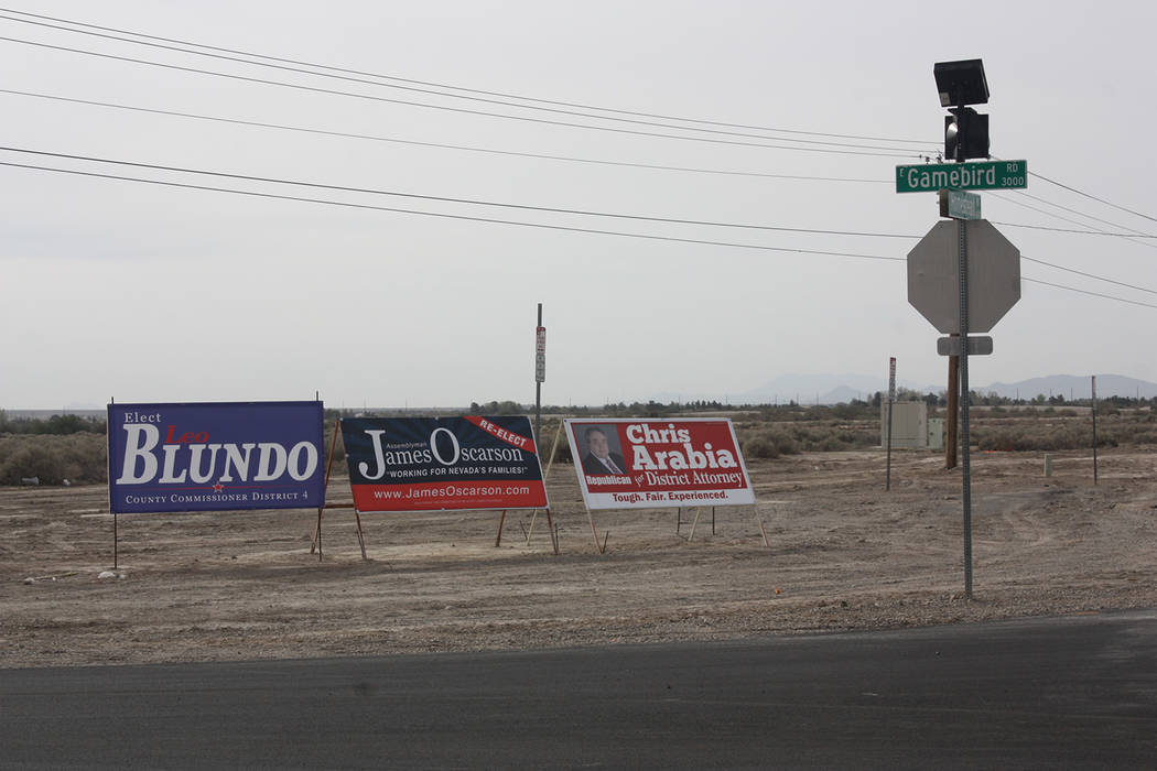 Robin Hebrock/Pahrump Valley Times Intersections are always popular locations for campaign signs, such as these at the corner of Homestead and Gamebird roads in Pahrump.