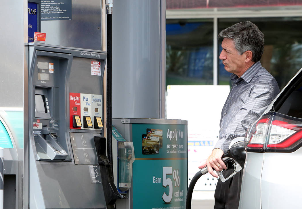 Bizuayehu Tesfaye/Las Vegas Review-Journal A customer pumps gas at Chevron gas station in Las Vegas on Monday, April 2, 2018, in Las Vegas.  Prices are on the increase across Nevada.