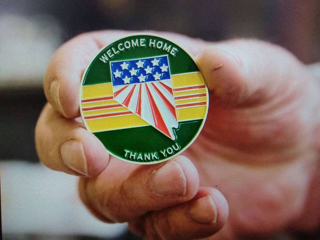 """Jeff Scheid/Special to the Pahrump Valley Times Upwards of 170 Vietnam Veterans received an official """"Welcome Home Coin and Vietnam Veteran cap at the ceremony. The hour-long event open to all vet ..."""