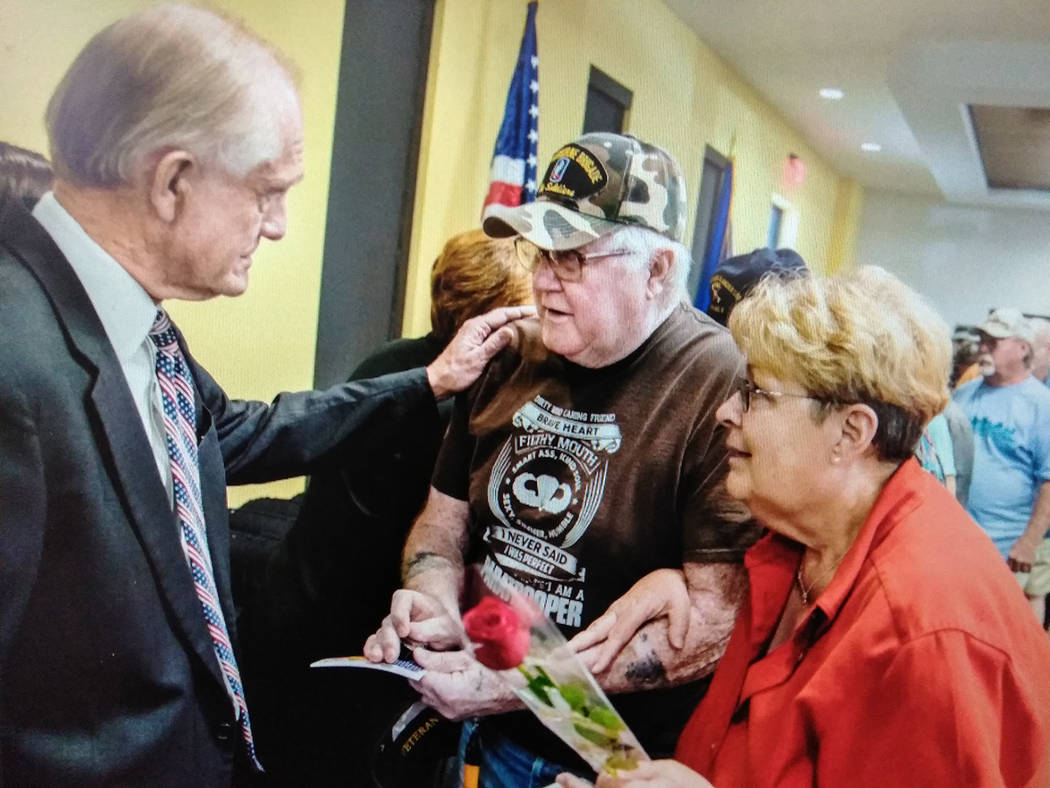 Jeff Scheid/Special to the Pahrump Valley Times Las Vegas PBS General Manager Tom Axtell, left, greets a Vietnam Veteran during the March 29, Welcome Home ceremony at Valley Electric Association's ...