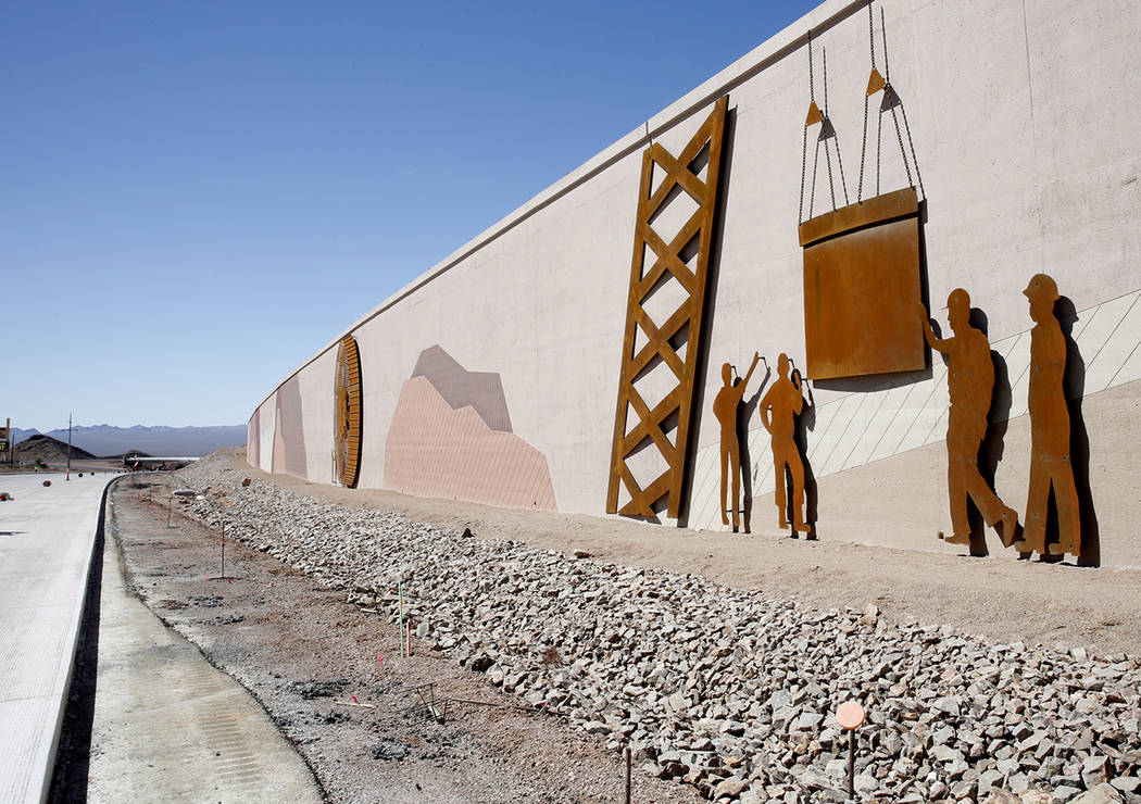 Bizuayehu Tesfaye/Las Vegas Review-Journal The design on the wall near the construction site of I-11, captures the history of the establishment of Boulder City and the construction of Hoover Dam o ...