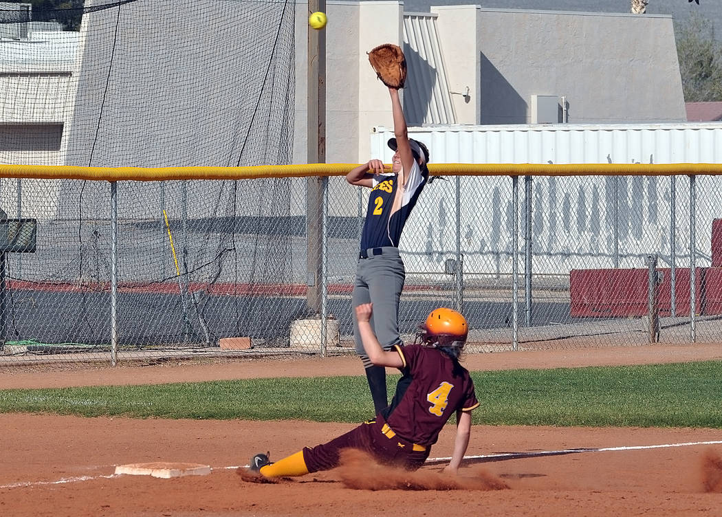 Horace Langford Jr./Pahrump Valley Times Pahrump Valley senior Kathy Niles slides safely into third base during Tuesday's home game against Boulder City.