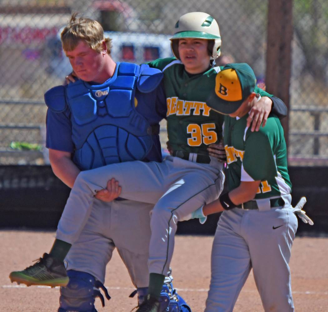 Richard Stephens/Special to the Pahrump Valley Times Daniel Castillo is carried off the field after injuring himself while successfully eluding a tag on a steal of third March 27 against Pahranaga ...