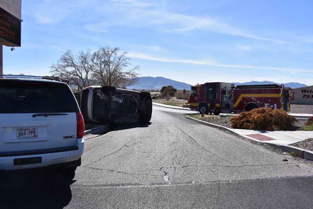 Special to the Pahrump Valley Times The intersection of Calvada Boulevard and Highway 160 was entirely blocked off while crews worked the scene of a two-vehicle crash last Friday afternoon. Two pe ...