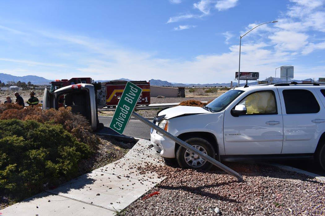 Special to the Pahrump Valley Times Two people were transported to Desert View Hospital after two-vehicle crash along Highway 160 at Calvada Boulevard last Friday. Pahrump Valley Fire and Rescue S ...