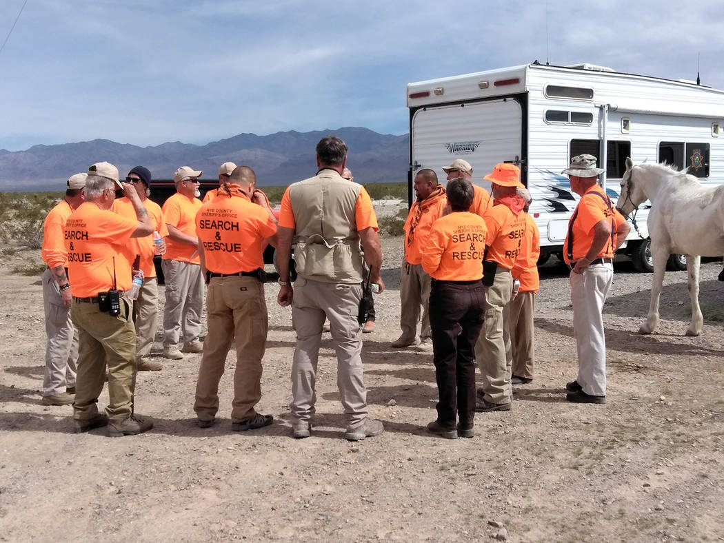 Selwyn Harris/Pahrump Valley Times Nye County Detectives and Serach and Rescue crews scoured the desert area near Basin Avenue and Powerline Road Friday morning in regards to a cold case. The sher ...