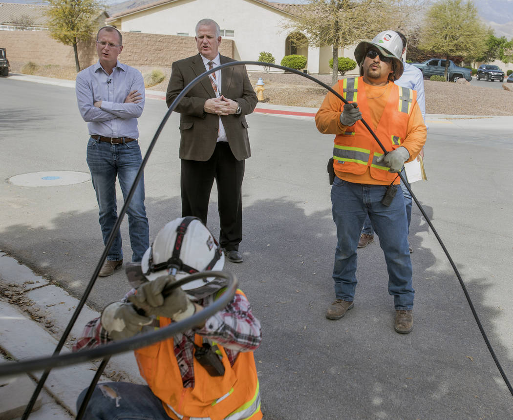 Special to the Pahrump Valley Times/Jeff Scheid Federal Communications Commissioner Brendan Carr (left) looks on as workers lay fiber-optic cables on April 9, 2018. Carr is working to reduce what  ...