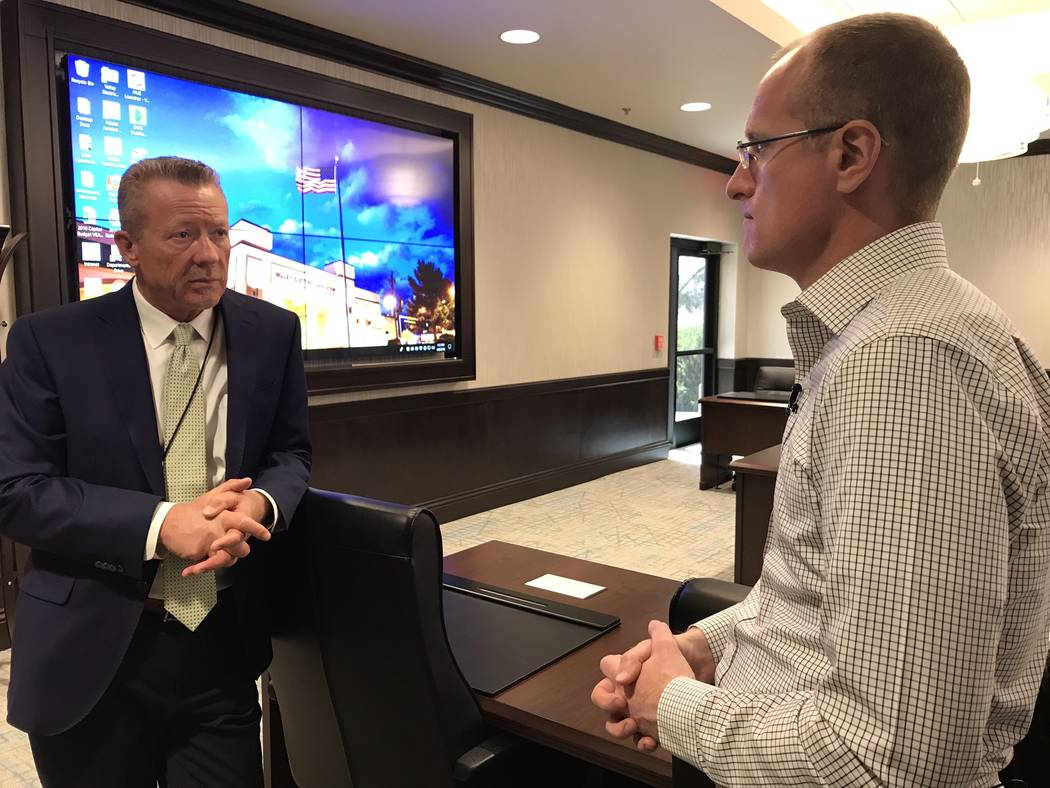 Jeffrey Meehan/Pahrump Valley Times Thomas Husted (left), CEO of Valley Electric Association, speaks with Federal Communications Commissioner Brendan Carr on April 9, 2018 at Valley's headquarters ...
