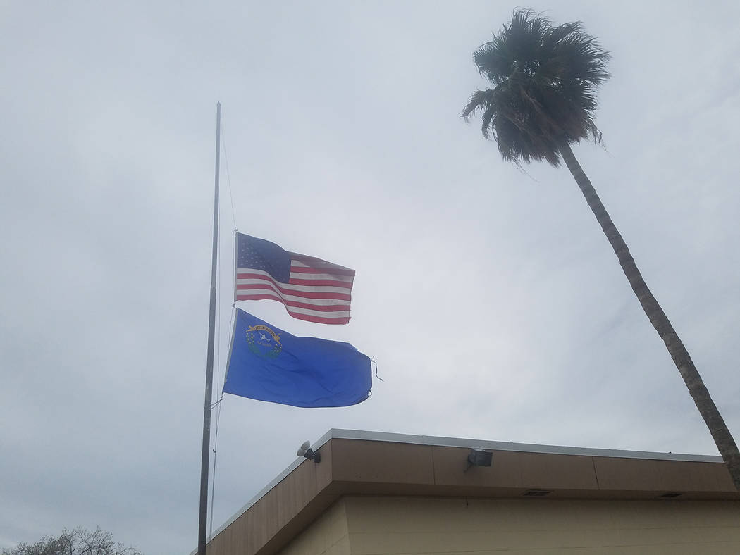 David Jacobs/Pahrump Valley Times The American and Nevada flags fly at half-staff outside the Bob Ruud Community Center in honor of Maj. Stephen Del Bagno. He died when his F-16 Fighting Falcon je ...