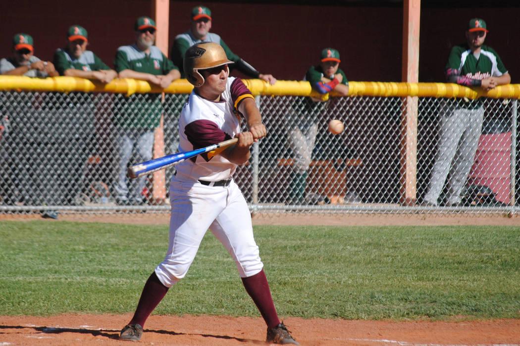 Charlotte Uyeno/Pahrump Valley Times Pahrump Valley's Anthony Charles hits an RBI single against Mojave last year. Charles foiled the Rattlers again Monday, driving in the tying and winning runs i ...