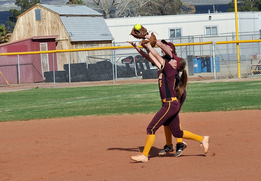 Horace Langford Jr./Pahrump Valley Times Jackie Stobbe and Skyler Lauver nearly collide making a play during a March 13 game against Del Sol. Trojans coach Eli Armendariz singled out Stobbe for he ...