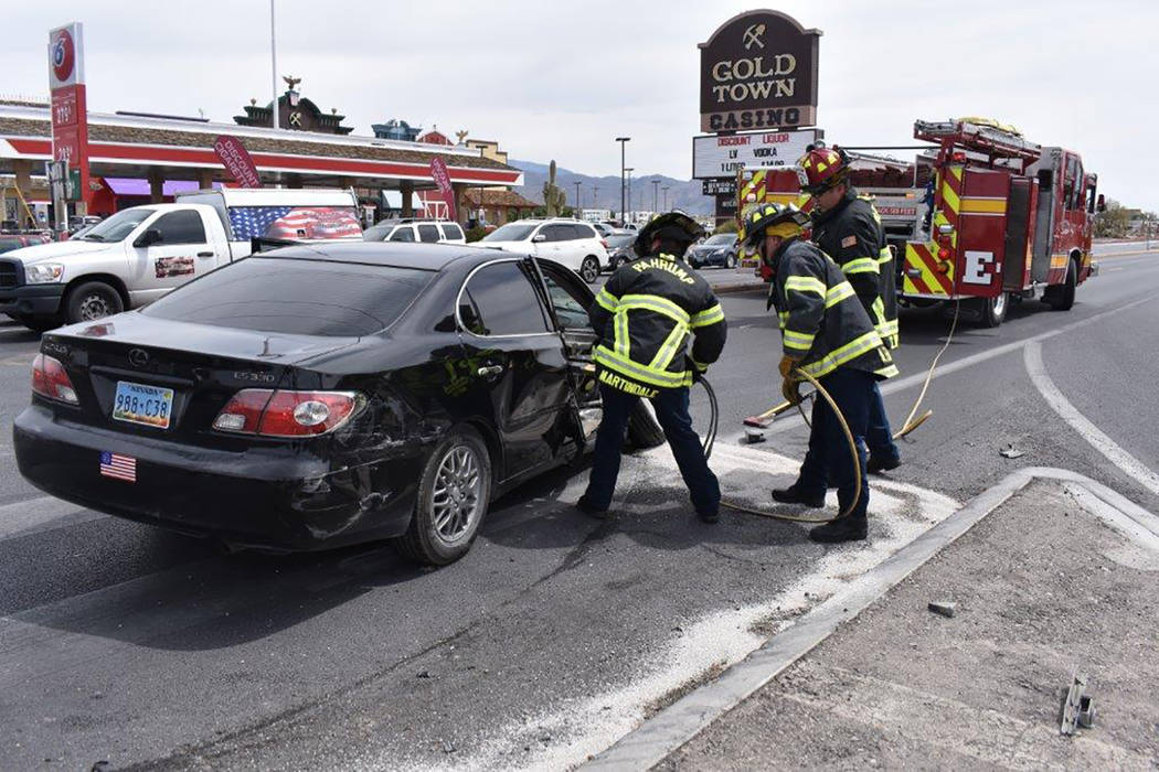Special to the Pahrump Valley Times Pahrump fire crews perform a door-pop to free a passenger involved in a two-vehicle crash at Highway's 160 and 372 last Wednesday afternoon. Two people were eve ...