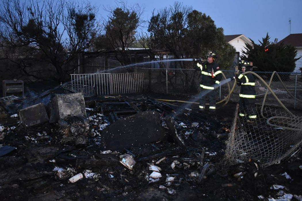 Special to the Pahrump Valley Times Pahrump firefighters extinguished what began as a 6:15 p.m., structure fire on Sunday evening April 8. Fire crews arrived to find a fully-involved travel traile ...