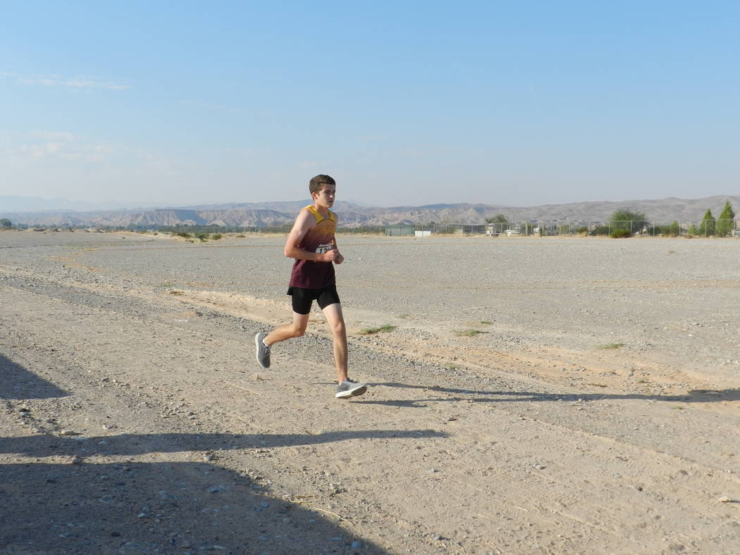 Special to the Pahrump Valley Times Senior Craig Moore for the boys team toughs it out at the Moapa Valley Invite as shown in a file photo.
