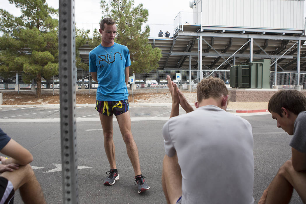 Bridget Bennett/Las Vegas Review-Journal Bryce Odegard talks with Pahrump Valley cross country running teammates prior to practice at Pahrump Valley High School on Tuesday, Sept. 5, 2017.