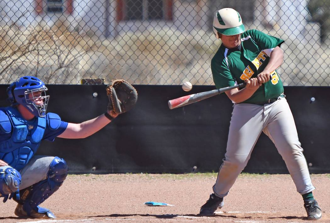 Richard Stephens/Special to the Pahrump Valley Times Juan Lopez keeps his eye on the ball during Beatty's doubleheader loss to Pahranagat Valley on March 27. Lopez started at catcher and took a tu ...