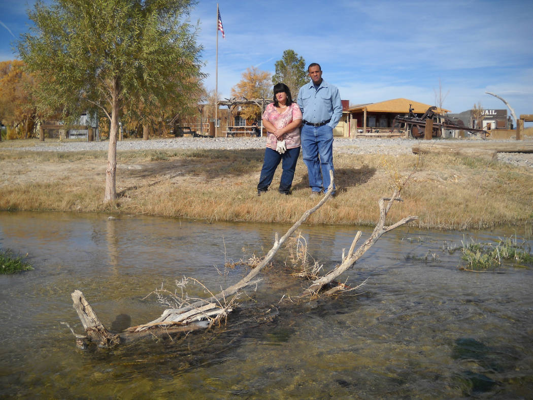Pahrump Valley Times Victor and Annette Fuentes stand in front of a flooded approach to their church camp in this 2007 file photo. The property has dramatically changed since then, due to U.S. Fi ...