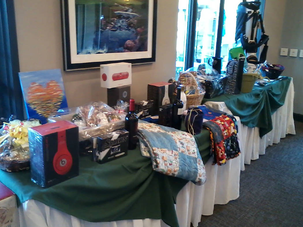 Tom Rysinski/Pahrump Valley Times Items donated to the 23rd annual Quarter Auction on display at the Grill Room at Mountain Falls Golf Club before the event Saturday, April 14.