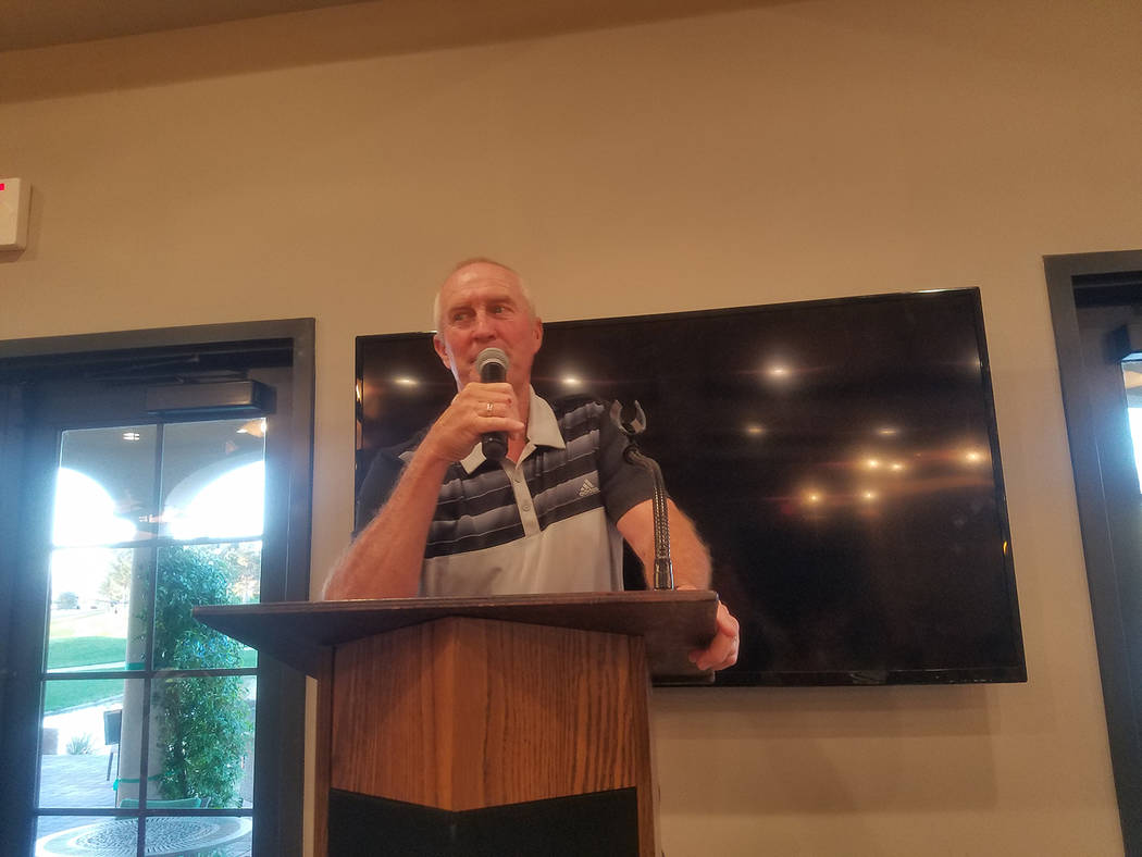David Jacobs/Pahrump Valley Times Bob Hopkins, Pahrump Valley High School golf coach, speaks to the crowd at the Quarter Auction. Throughout the evening, Hopkins called out the winning numbers for ...