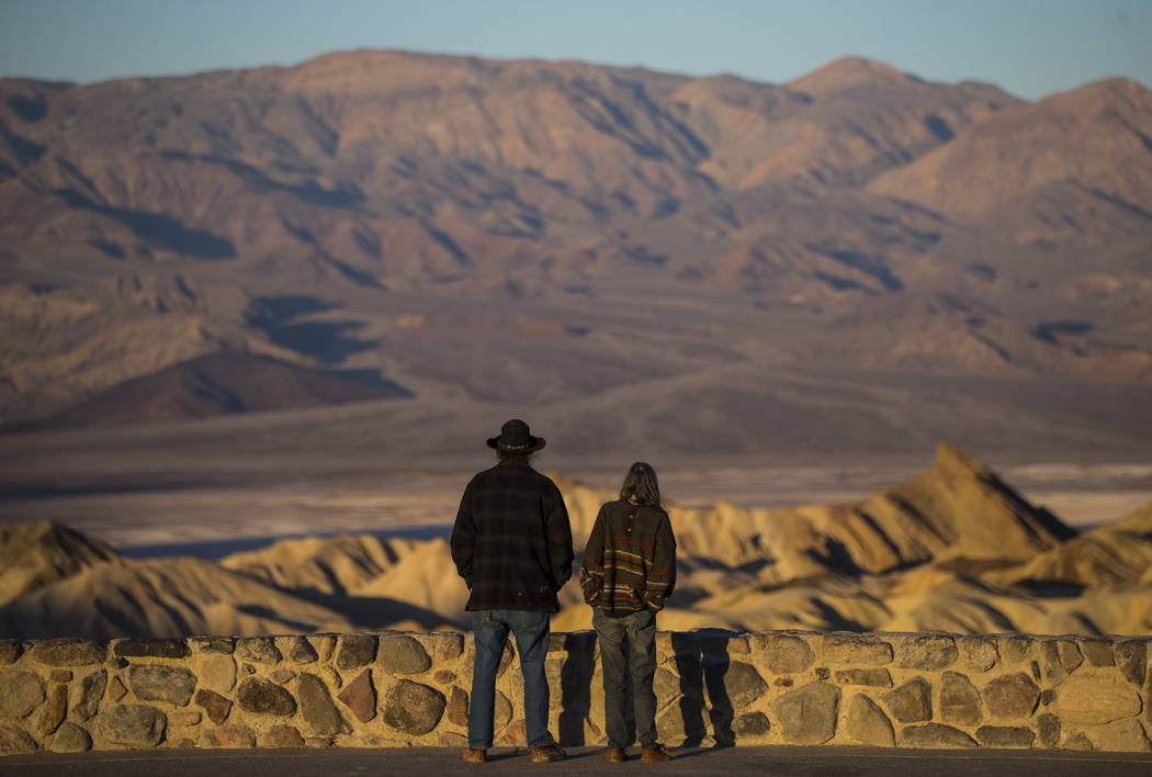 Chase Stevens/Las Vegas Review-Journal People take in a view of sunrise from Zabriskie Point in Death Valley National Park, Calif, on Wednesday, Jan. 24, 2018. Starting June 1, all 117 fee-collect ...
