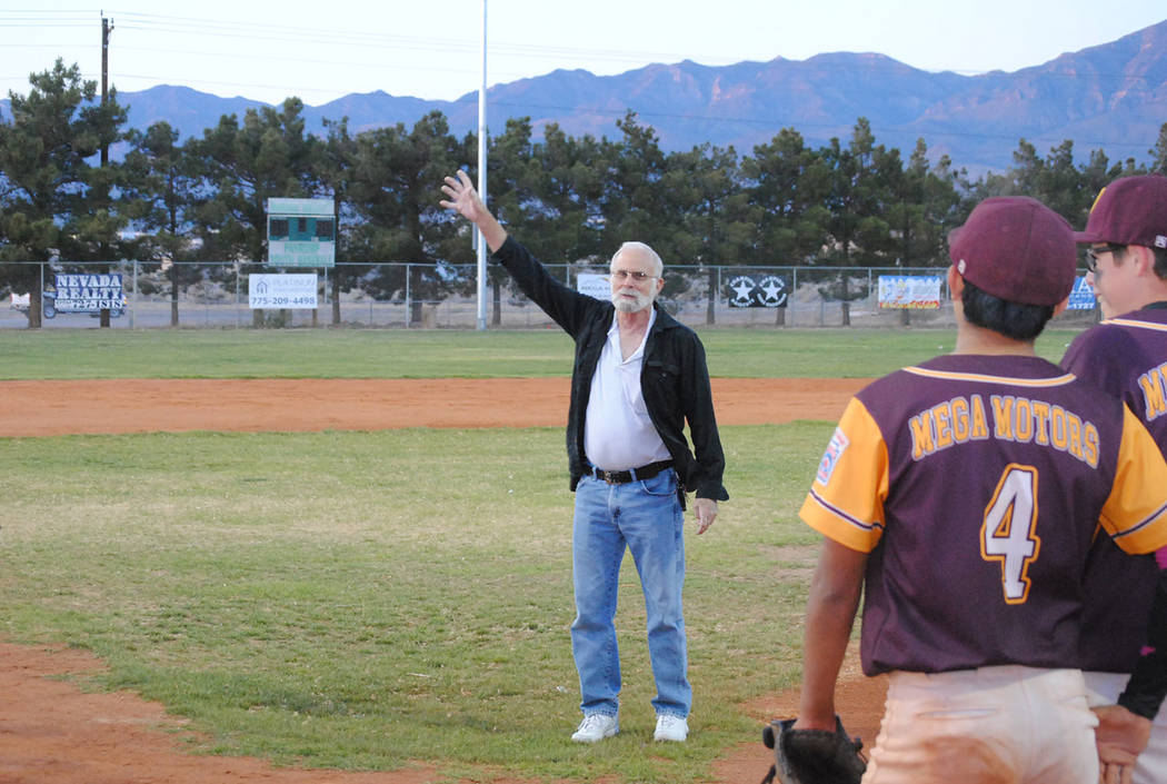 Charlotte Uyeno/Pahrump Valley Times Nye County Commission Chairman John Koenig waves to the crowd before a ceremony to dedicate the new lights at Ian Deutch Memorial Park.