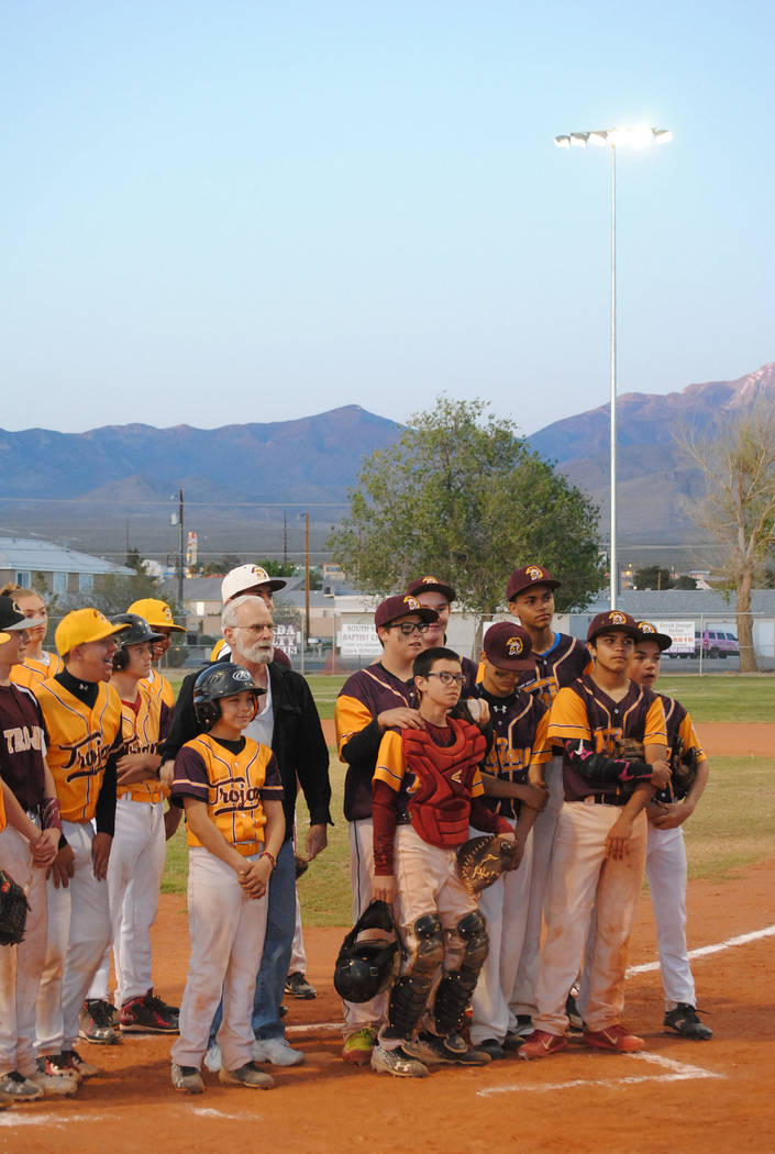 Charlotte Uyeno/Pahrump Valley Times P-Town Little League players took a break from their game to pose with Nye County Commission Chairman John Koenig at a ceremony unveiling Ian Deutch Memorial P ...