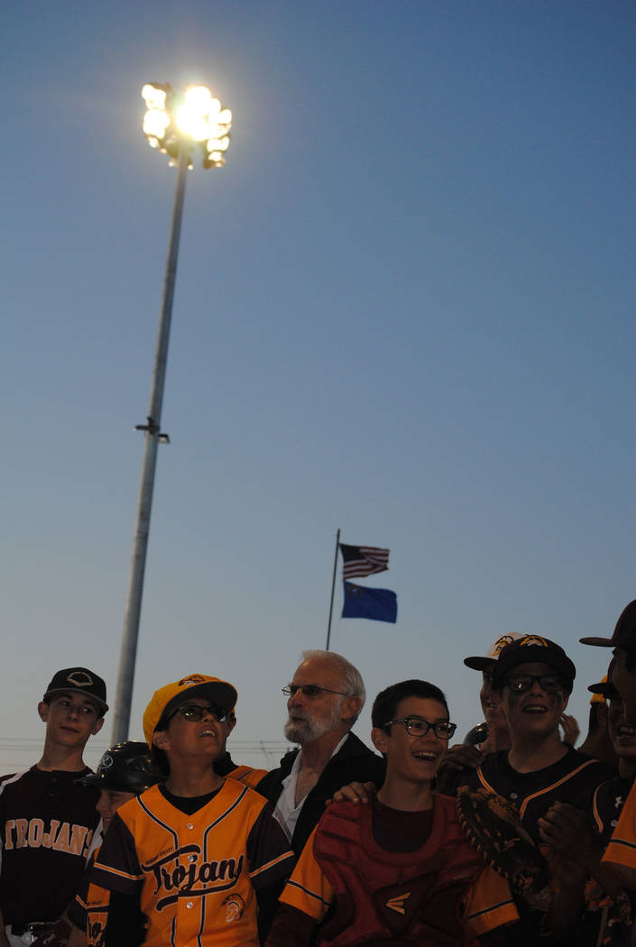 Charlotte Uyeno/Pahrump Valley Times Light from the new system at Ian Deutch Memorial Park shines on Nye County Commission Chairman John Koenig and members of the P-Town Little League on Tuesday i ...