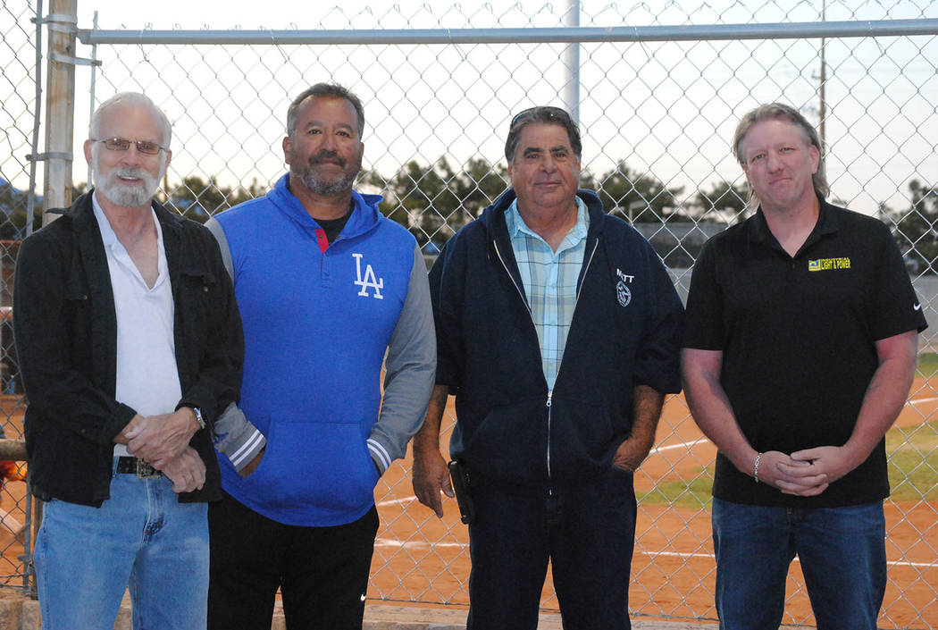 Charlotte Uyeno/Pahrump Valley Times From left, Nye County Commission Chairman John Koenig, P-Town Little League President Lou Banuelos, Pahrump Buildings and Grounds Supervisor Matt Luis and Andr ...