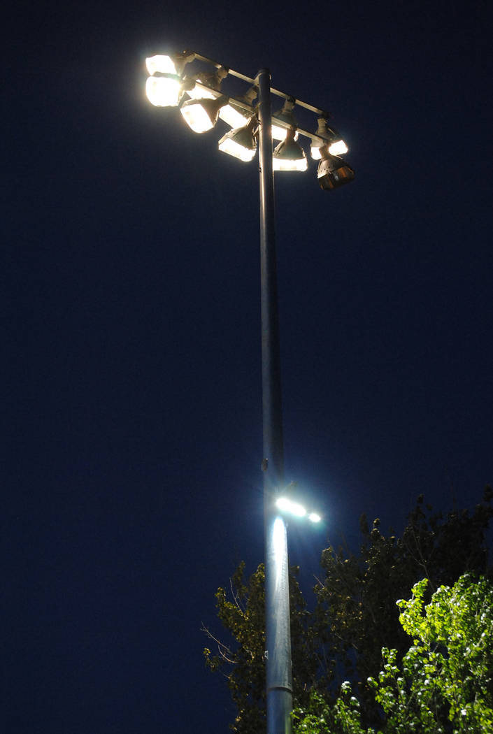Charlotte Uyeno/Pahrump Valley Times Ian Deutch Memorial Park's new lights shine brightly as darkness falls Tuesday during Little League games.