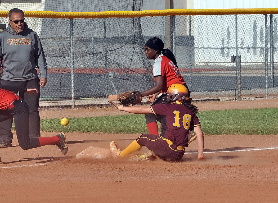 Horace Langford Jr./Pahrump Valley Times Pahrump Valley sophomore McKayla Bartley slides safely into third base while coach Eli Armendariz looks on from the third-base coaching box during Monday's ...