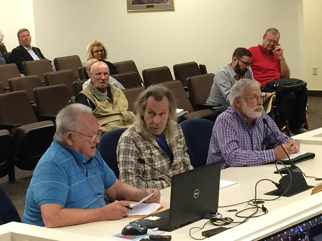 Robin Hebrock/Pahrump Valley Times Nye County residents John Bosta and Kenny Bent, left and second from left, spoke against passage of the newest version of the GMP. Dave Hall, chairman of the wat ...