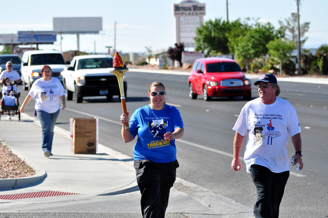 Horace Langford Jr. Pahrump Valley Times A Special Olympics athlete is seen carrying the torch down Nevada Highway 160 in this 2015 file photo. Today, Nye County Sheriff's Office deputies will j ...