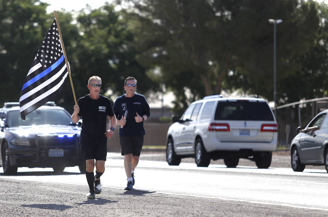 Retired North Las Vegas police chief Joseph Forti, 62, left, and retired Las Vegas Metro police captain Daniel Barry, 59, right, runs during the 18th annual Nevada law enforcement officers memoria ...