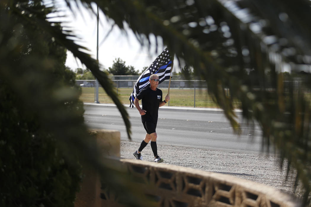 Retired North Las Vegas police chief Joseph Forti, 62, runs during the 18th annual Nevada law enforcement officers memorial run on Wednesday, April 26, 2017, in Las Vegas. Forti usually runs the r ...