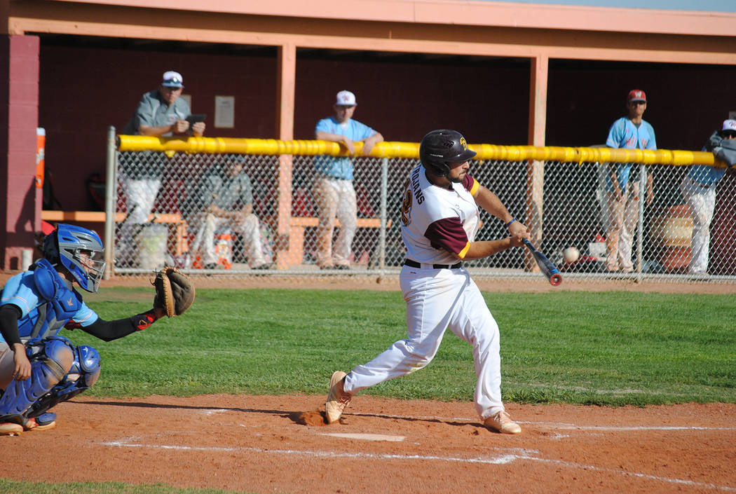 Charlotte Uyeno/Pahrump Valley Times Anthony Charles connects for a base hit against Mojave during Pahrump Valley's 4-3 win April 9 in Pahrump.