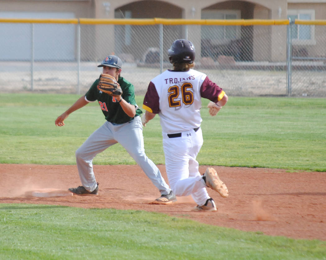 Charlotte Uyeno/Pahrump Valley Times Pahrump Valley's Tyler Floyd steals second base during an April 9 home win over Mojave. Floyd doubled and scored in the Trojans' 5-3 win Wednesday over Desert ...