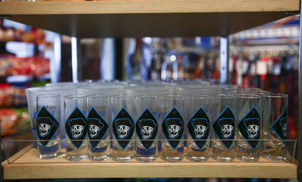 """Shot glasses featuring the special Las Vegas 51s """"Reyes de Plata"""" (Silver Kings) name, part of a new Minor League Baseball initiative, are displayed at the team store at Cashman Field in ..."""
