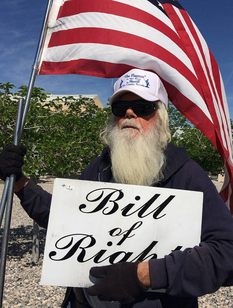 "Robin Hebrock/Pahrump Valley Times Nye County Sheriff candidate Ray ""The Flagman"" Mielzynski."