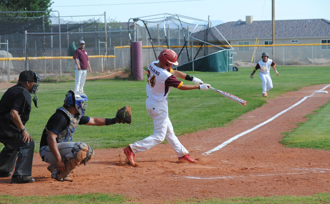 Charlotte Uyeno/Pahrump Valley Times Willie Lucas connects for a two-run double to deep center field during Pahrump Valley's 5-3 win over Desert Pines on April 25 in Pahrump.